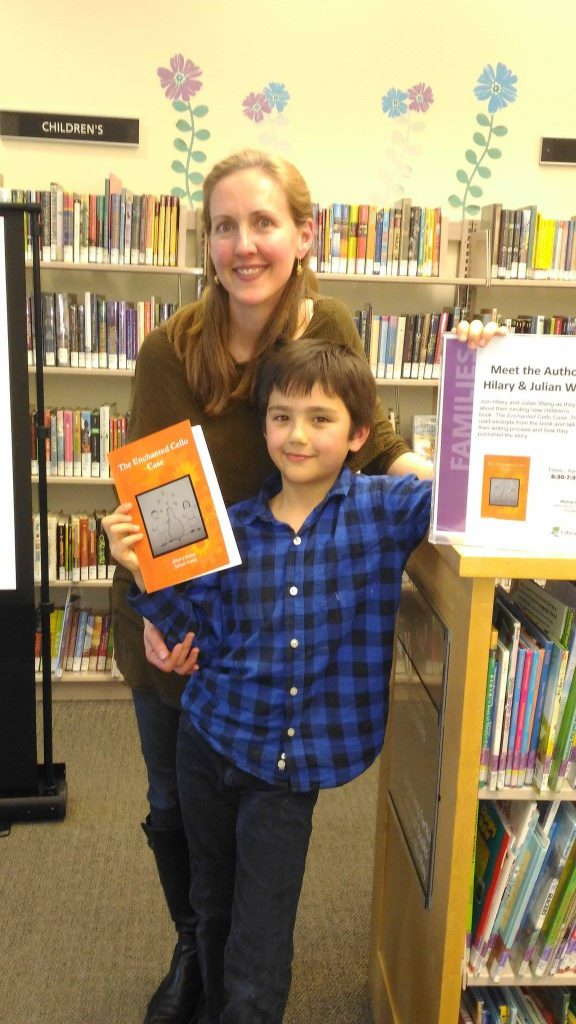 Hilary and Julian Wang at the Multnomah County Library holding their book: The Enchanted Cello Case
