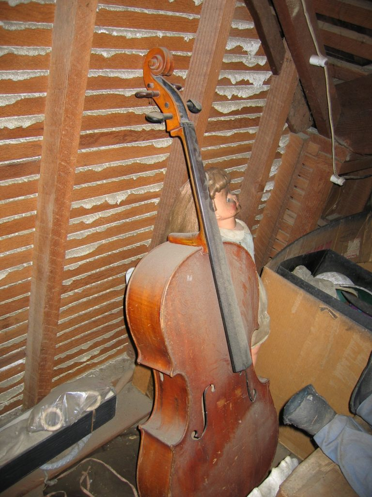 The cello as discovered in the attic (2004). Photo courtesy Melani Carty.