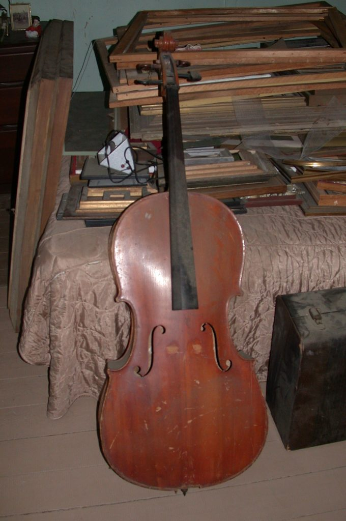 The cello after being discovered in the attic.