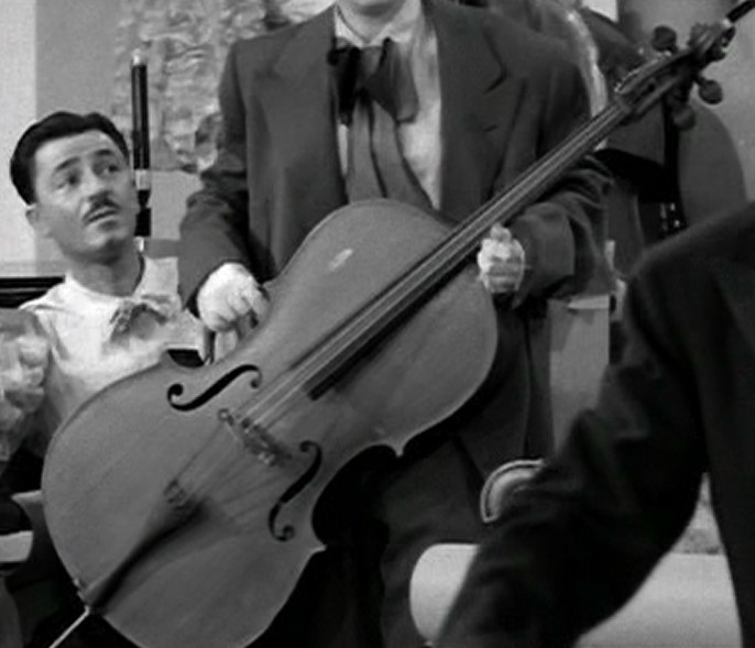 """""""Loaded"""" cello with a handle on the C-bout and its endpin out. I Love Lucy cello."""