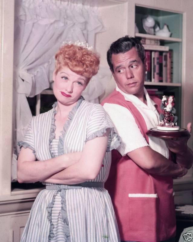 Lucille Ball and Desi Arnaz with an original figurine of Lucy with the cello.