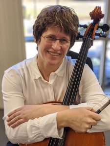 Brenda Neece, head and shoulders with modern cello