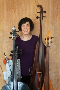 Erica Lessie with some of her Cellos of Unusual Shape (COUSes)