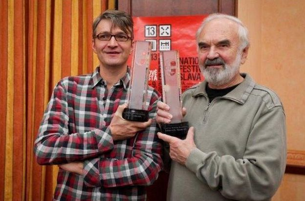 Son and Father, Jan and Zdenek Sverák with film awards.