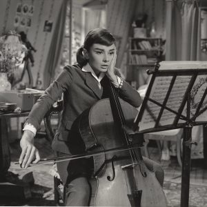 Audrey Hepburn with her cello in Love in the Afternoon. Copyright by production studio and/or distributor. Intended for editorial use only. Source: MovieStillsDB.