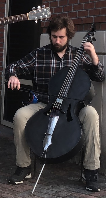Jared Harris with his Steel Cello – Uncontained Curiosity. Photo courtesy Jared Harris