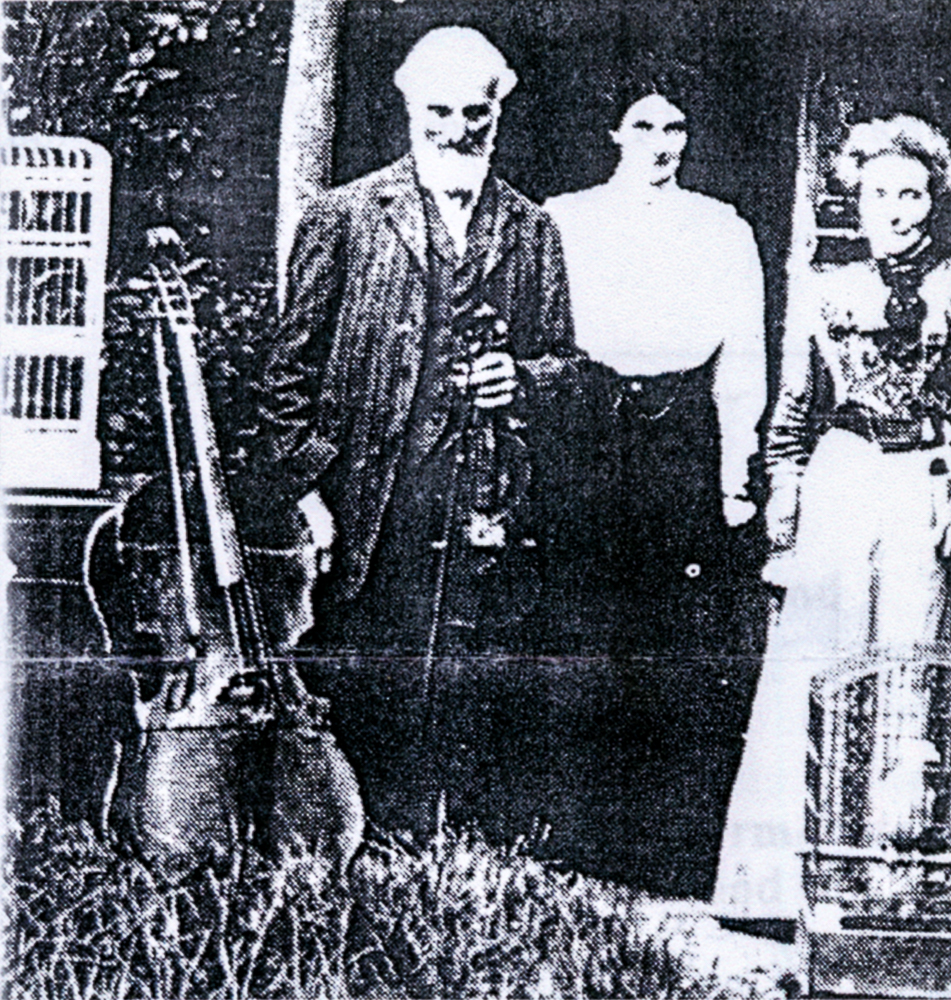Albert Elliff Hills with His Family, Birds, and the Iron Cello from St. Lawrence's, Caterham.