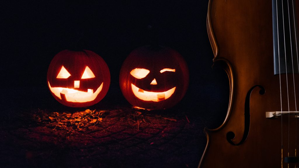 Cello with two jack o'lanterns
