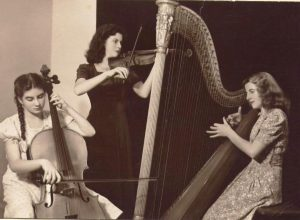 Maureen (cello) with her sisters Cathleen (violin) and Patricia (harp). Photo courtesy Leora O'Carroll